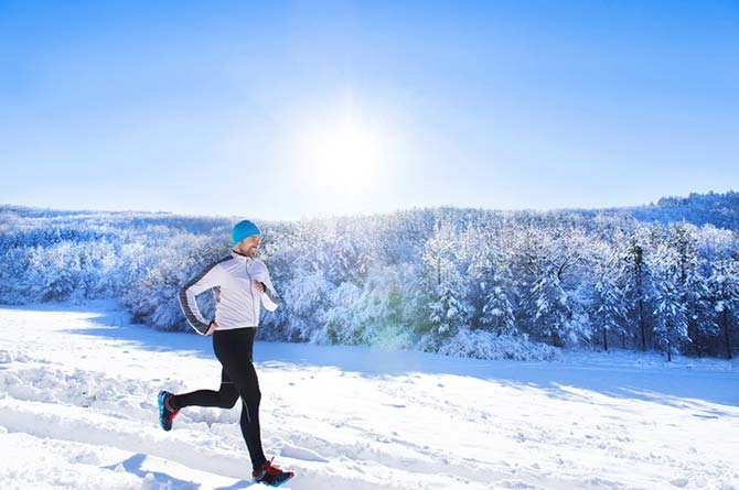 Jogger in a snow-covered landscape