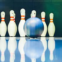 Bowling ball on a bowling alley rolling towards the bowling pins